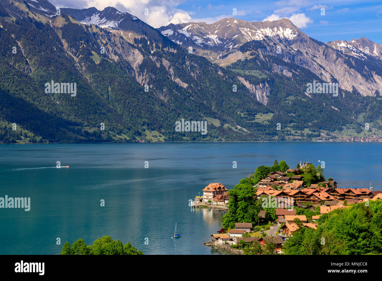 Lake Brienz with the village Iseltwald, Bernese Oberland, Switzerland - Stock Image