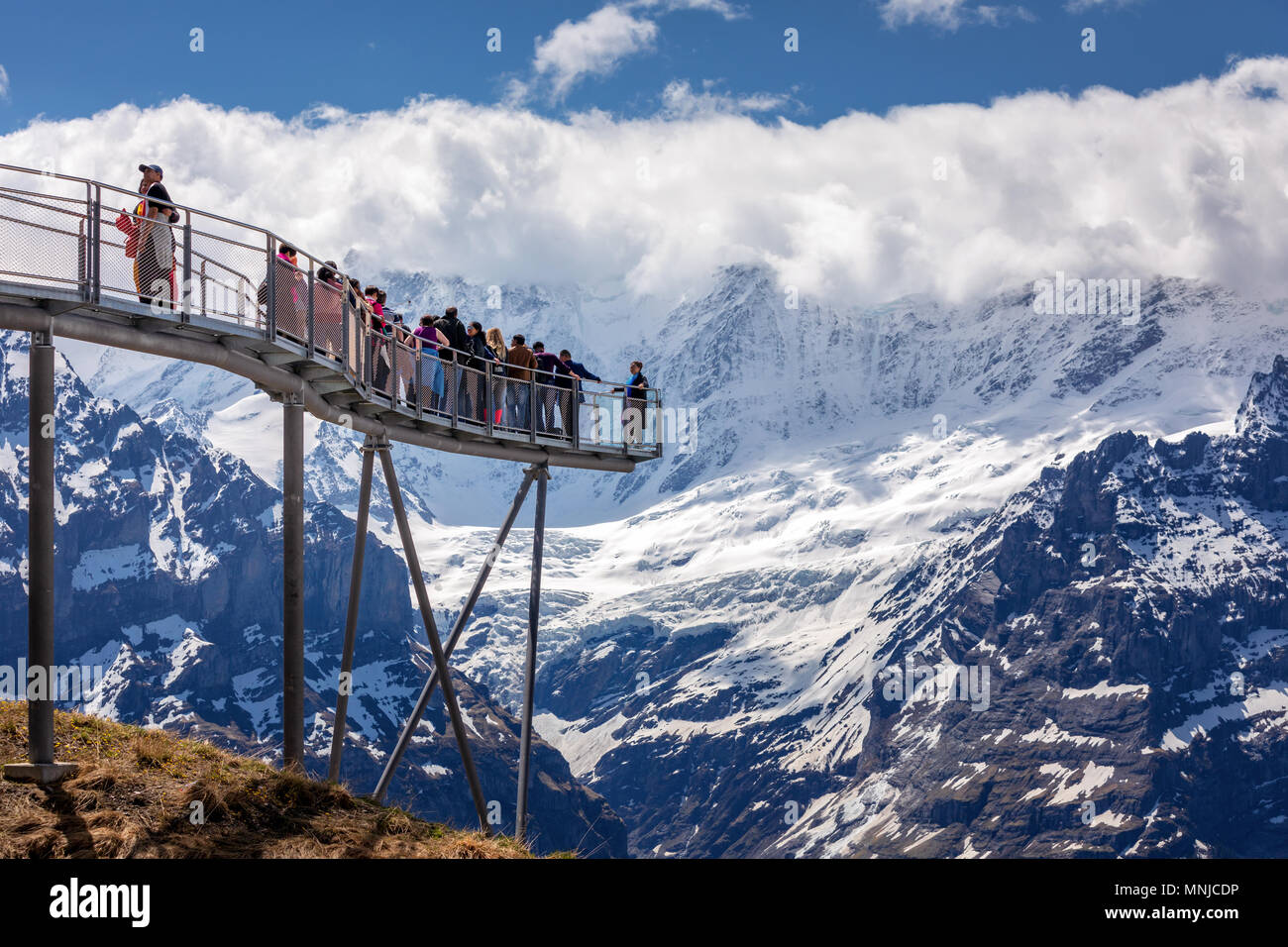 People on the observation platform at the top of First mountain above Grindelwald, Bernese Oberland, Switzerland - Stock Image