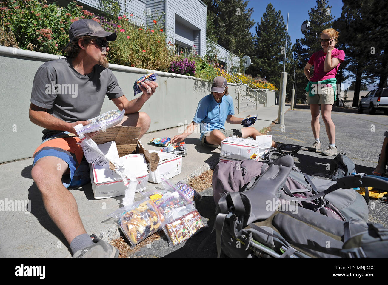 Backpackers resupply before long trail in town of Mammoth Lakes on trek of Sierra High Route in California, USA - Stock Image