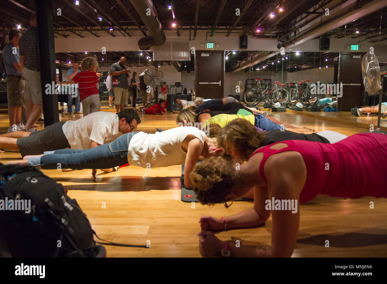 Group of people holding Plank in support of Human Trafficking Awareness, Edina, Minnesota, USA - Stock Image