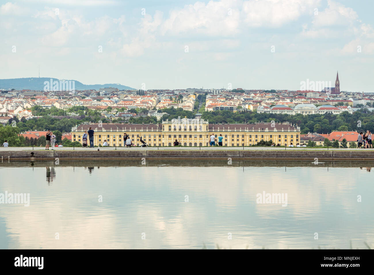Vienna Austria May.10 2018, Schonbrunn castle view from Gloriette at low with the pond reflecting the sky against cityscape - Stock Image