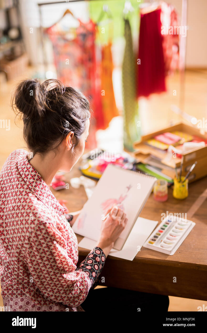 Fashion designer working on a new model, in her studio Stock Photo