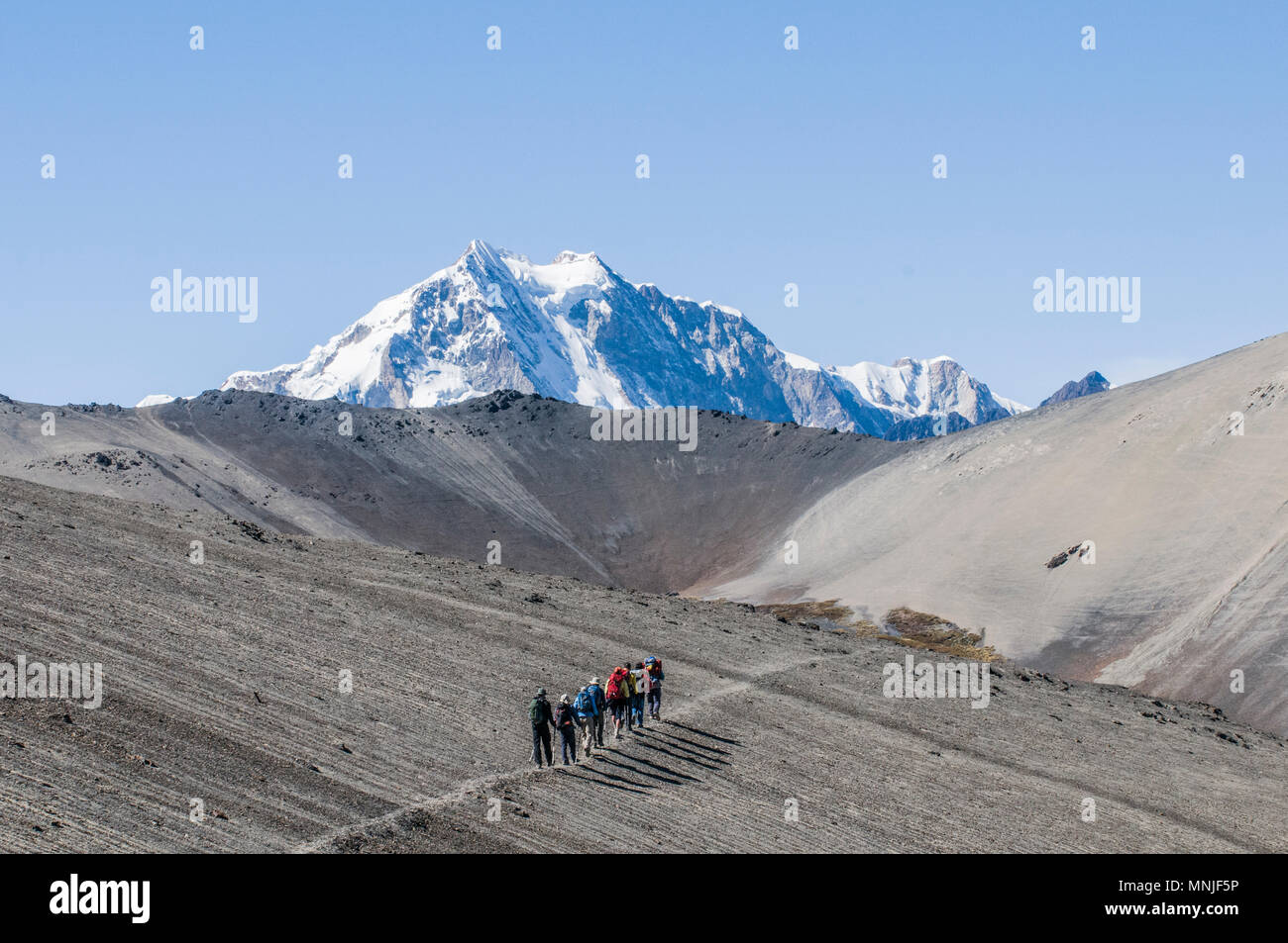 Treking in the Cordillera Real region of the Bolivian Andes with Huayan Potosi in the distance. - Stock Image