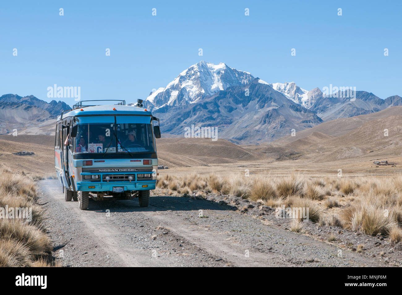 A local bus transporting hikers in the Cordillera Real region of the Bolivian Andes. - Stock Image