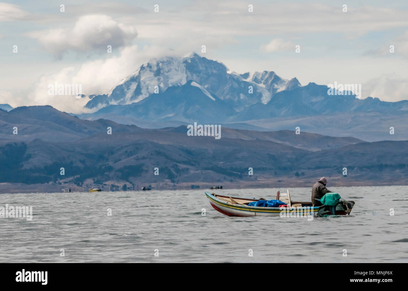 A fishing boat on Lake Titicaca, with Huayna Potosi in the background. - Stock Image
