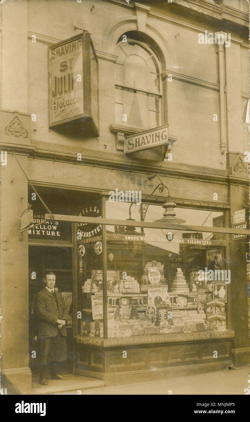 Advertising postcard for tobacconist and barber - Stock Image