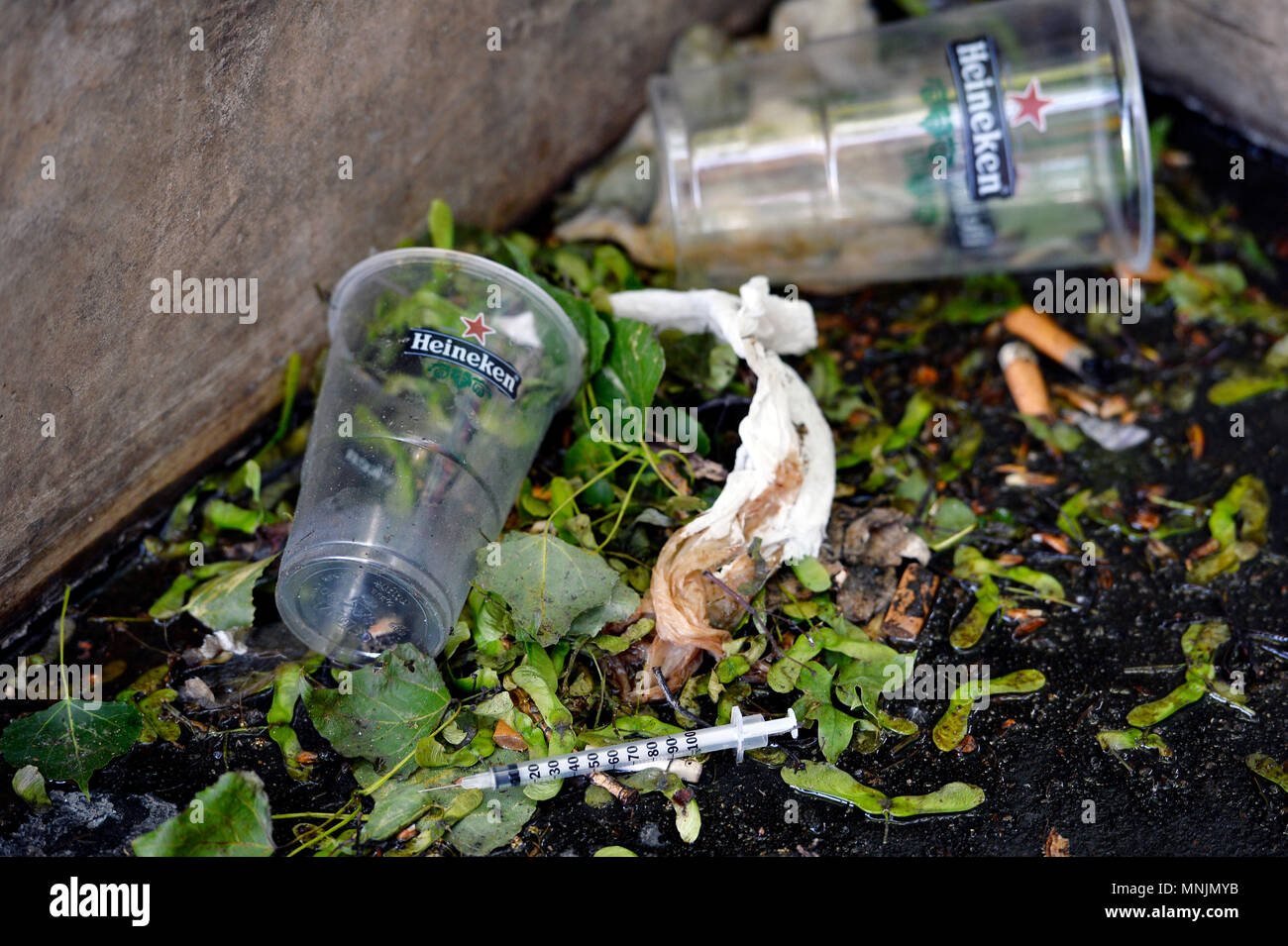Drug addict syringe thrown on the floor -  The Bassin de la Villette (La Villette Basin) is the largest artificial lake in Paris - Paris 19th - France - Stock Image