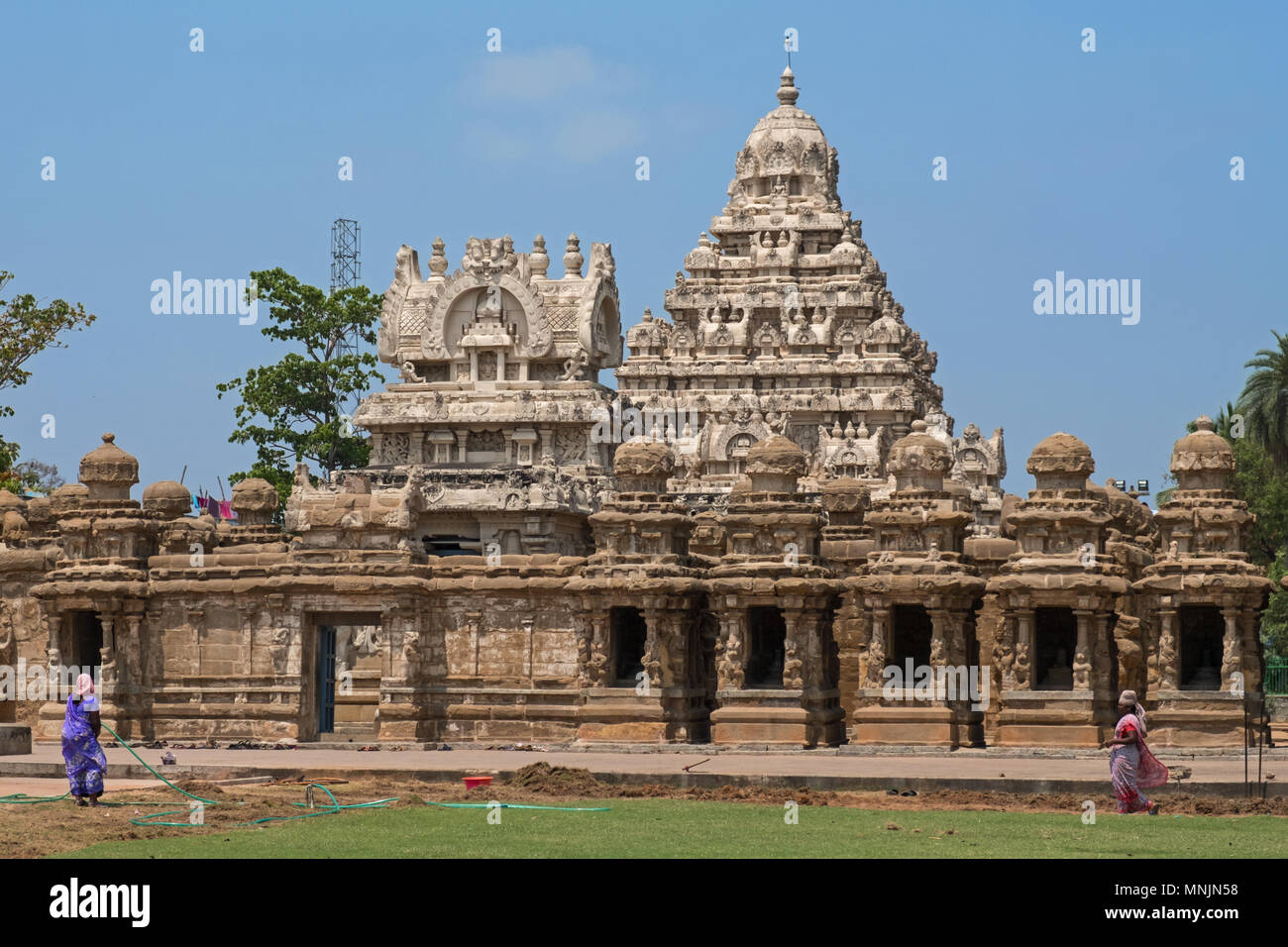 Kanchipuram, India - March 19, 2018: Local women working on. a landscaping project in front of the entrance to the 8th century Kailasanathar temple - Stock Image