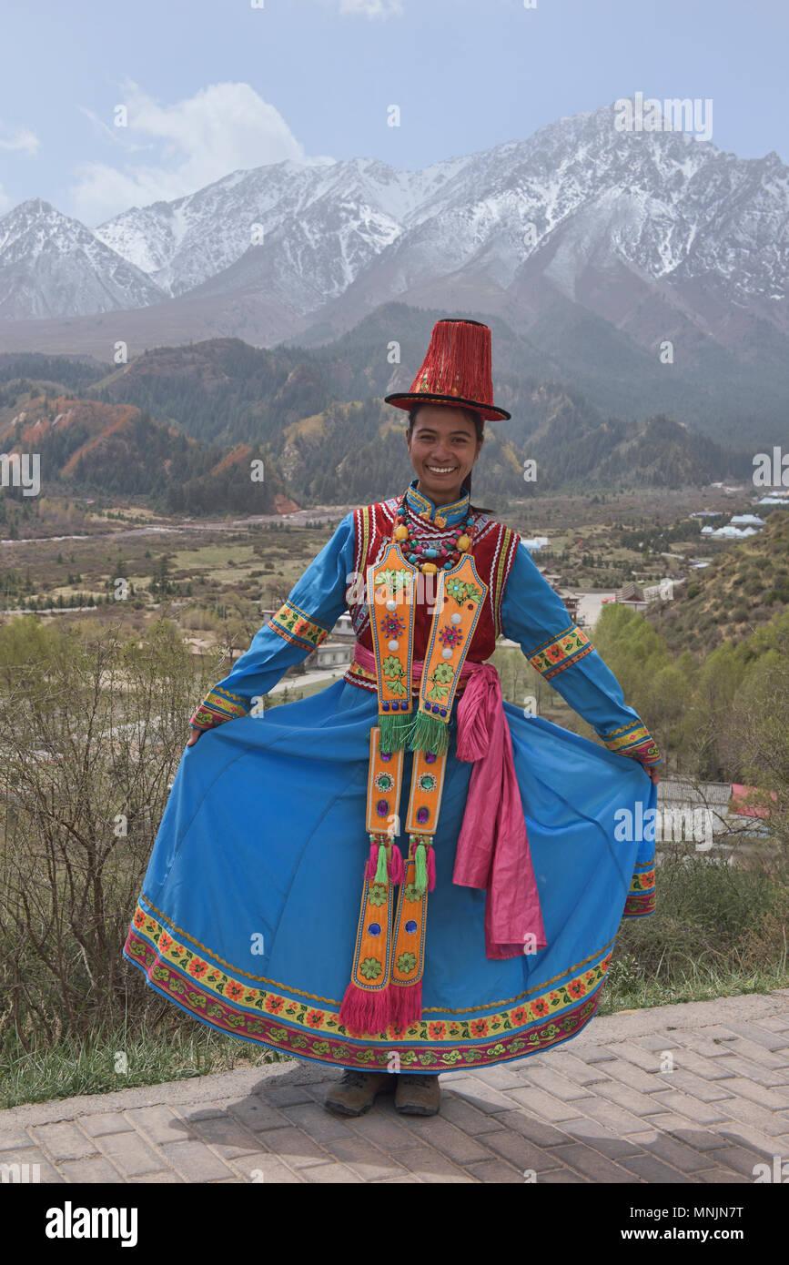 Traditional dress of the Yugur ethnic minority, Mati Si, Gansu, China - Stock Image