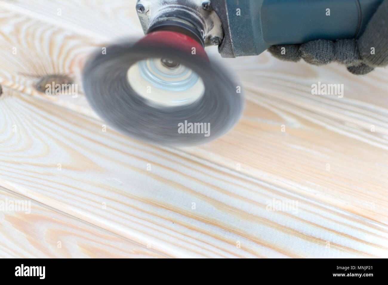 angle grinder with wood and wood brashing tool. - Stock Image