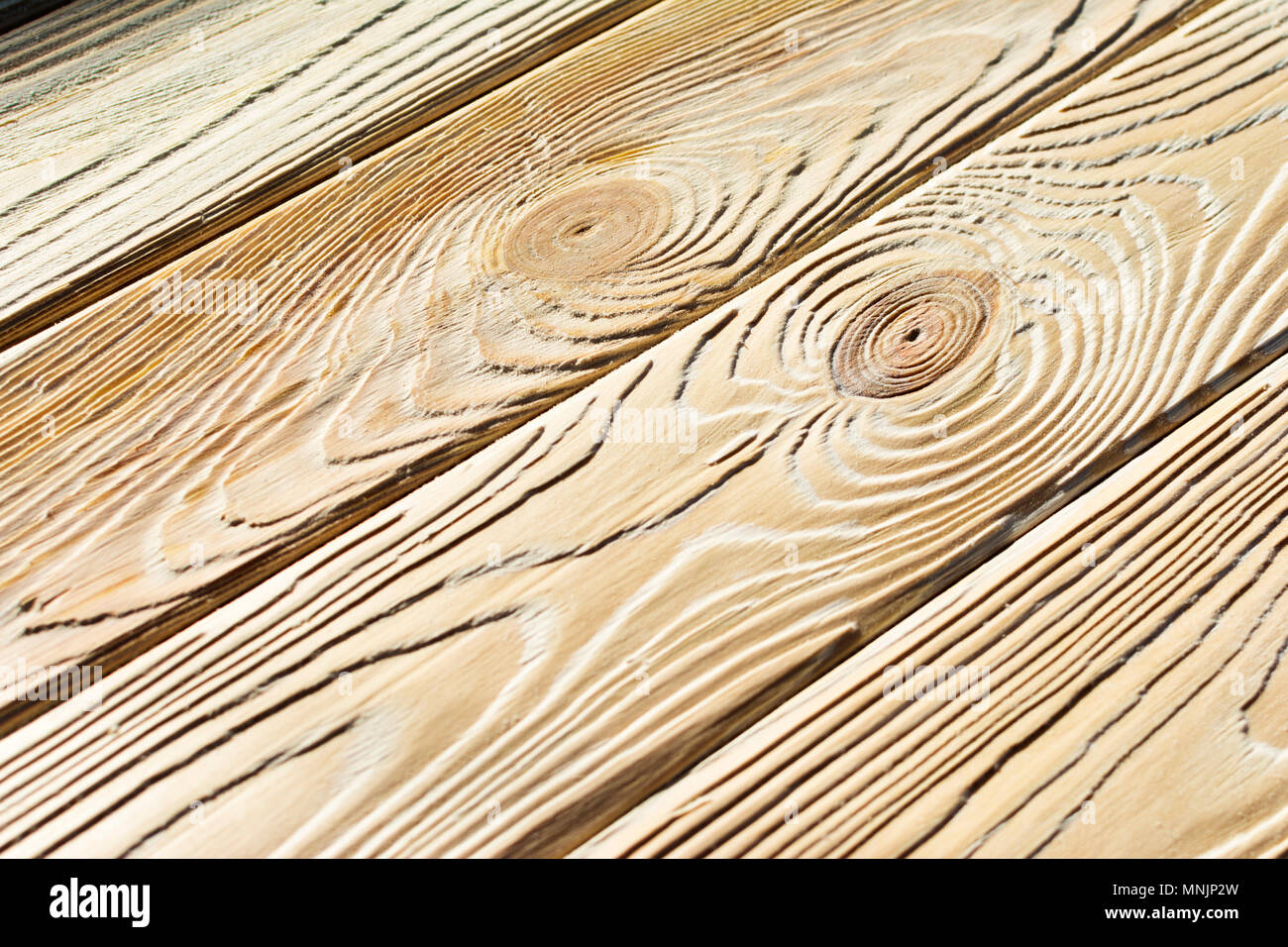 Wood after brashing by angle grinder. - Stock Image