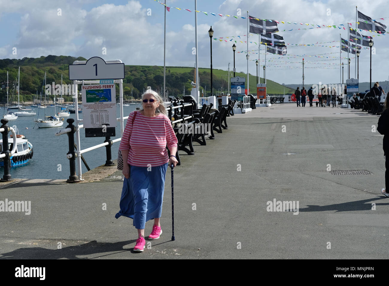 A lady with a walking stick in Falmouth, Cornwall. - Stock Image
