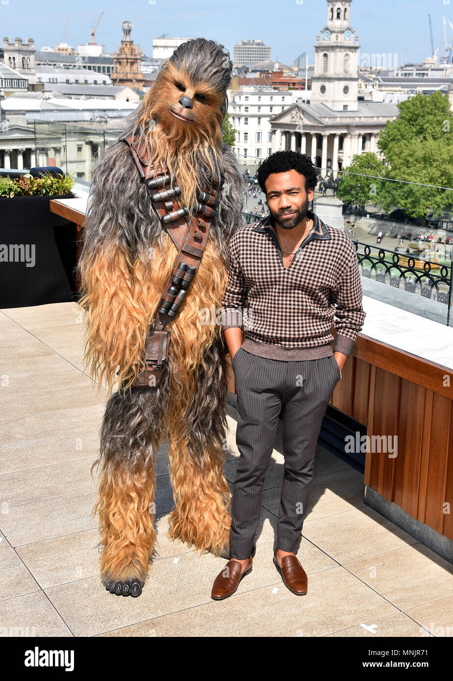 Donald Glover and Chewbacca attending the photocall for Solo: A Star Wars Story at The Trafalgar St. James, London. - Stock Image