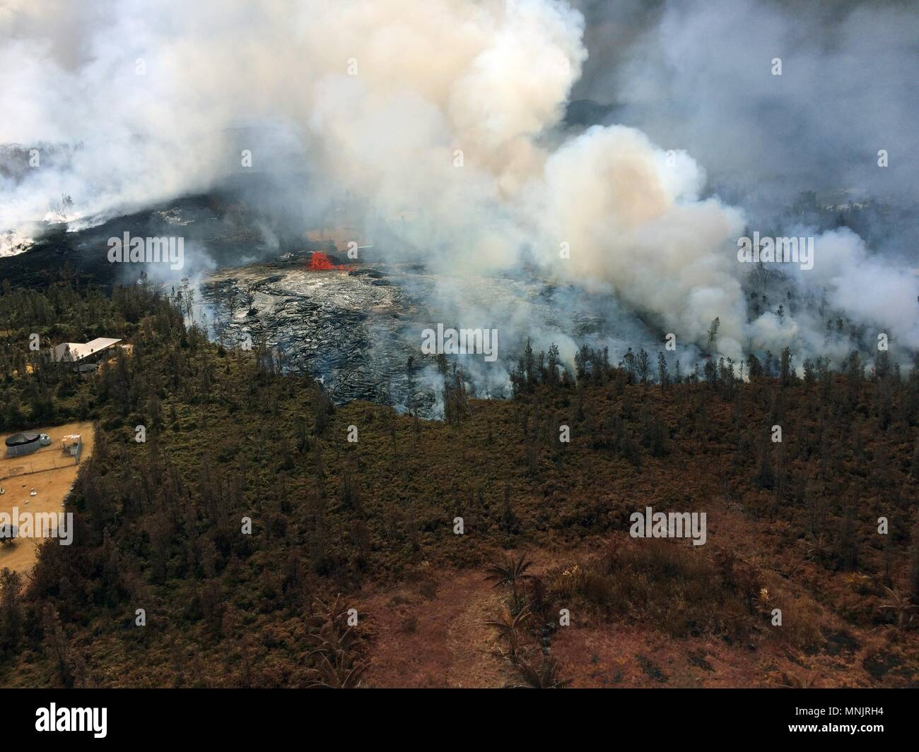 Aerial view of lava flowing and poison gases fissures in Leilani Estates caused by the eruption of the Kilauea volcano May 17, 2018 in Pahoa, Hawaii. - Stock Image