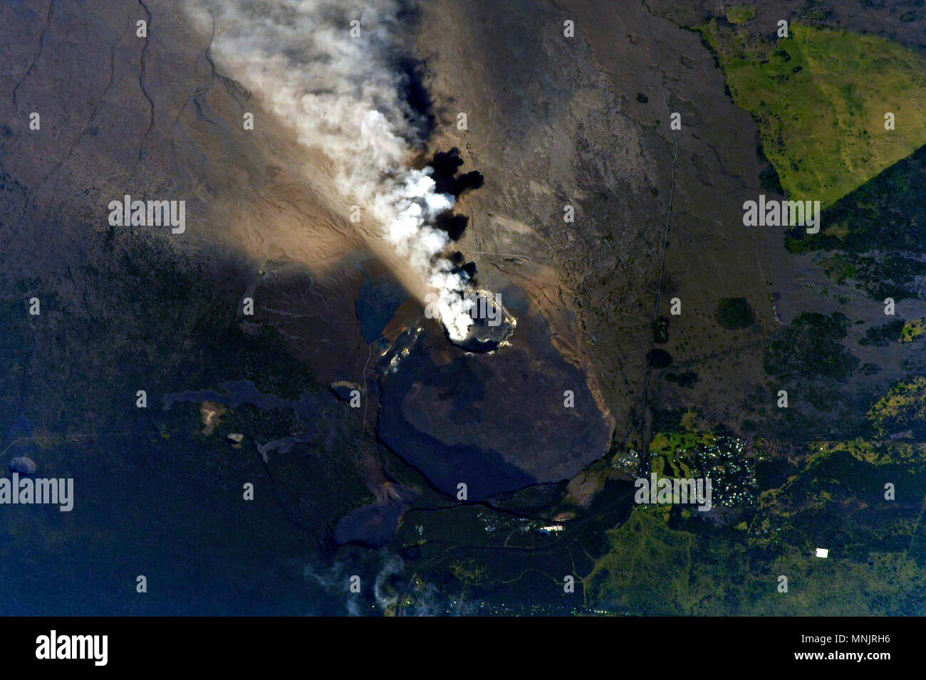 View from the International Space Station of ash and poison gases spewing from the eruption of the Kilauea volcano May 13, 2018 in Pahoa, Hawaii. - Stock Image