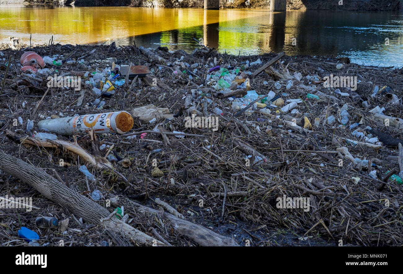 This small log jam on the Tennessee-Tombigbee River near Columbus, Ms. shows just how much plastic is thrown overboard in our nations waterways. It is - Stock Image