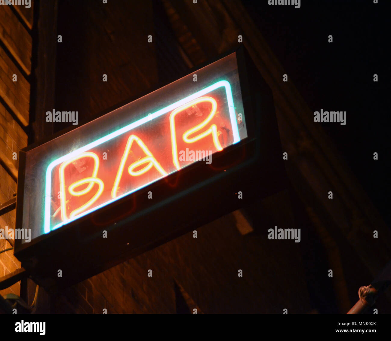 Orange and green neon bar sign in Dublin; Ireland - Stock Image