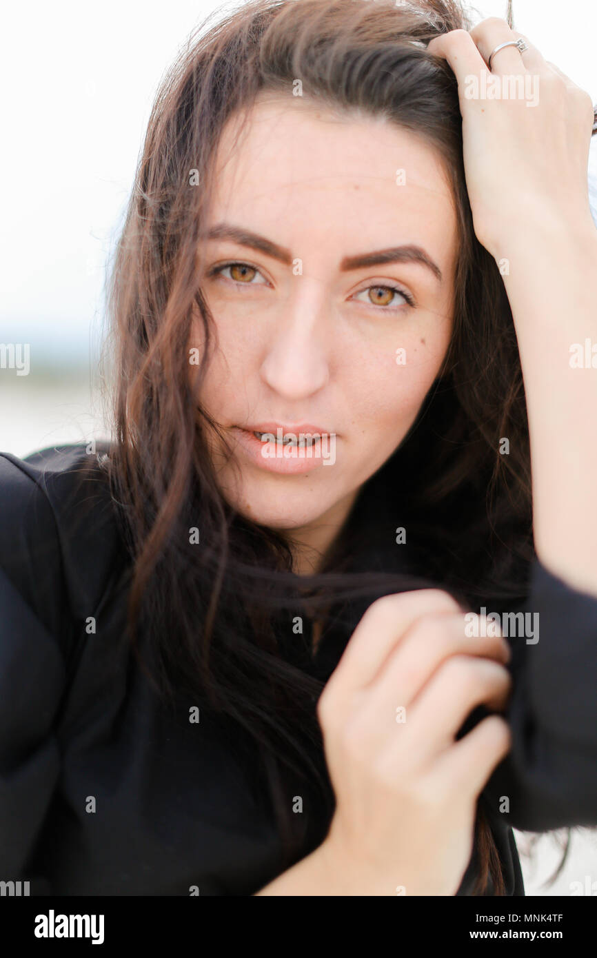 Close Up Of Caucasian Woman Without Makep And Cute Smile Having Black Hair And Brown