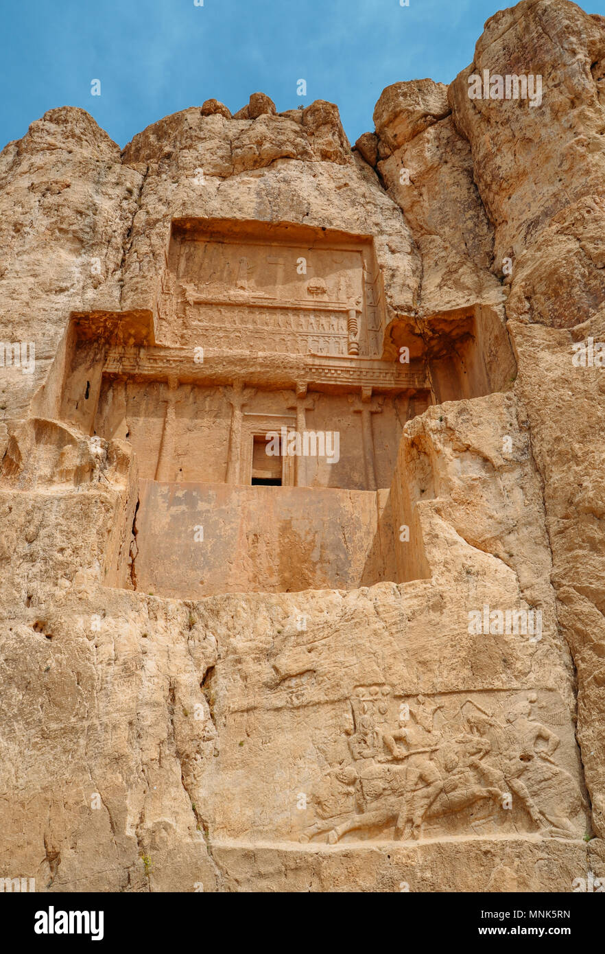 The ancient tombs of Achaemenid dynasty Kings of Persia are carved in rocky cliff in Naqsh-e Rustam, Iran. - Stock Image