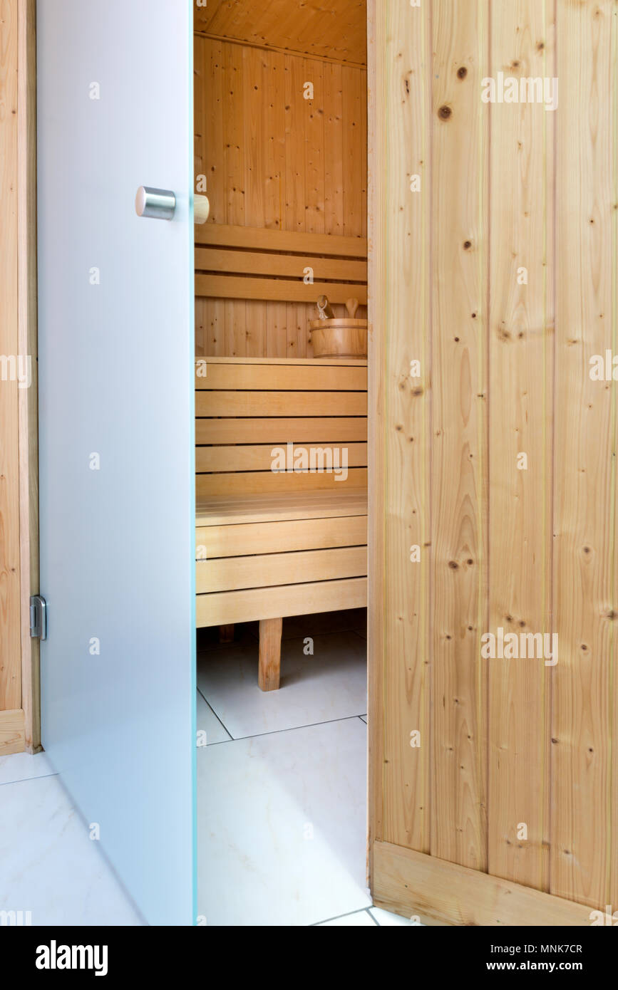 Open Glass Doors To Empty Finish Sauna In Natural Light Stock Photo