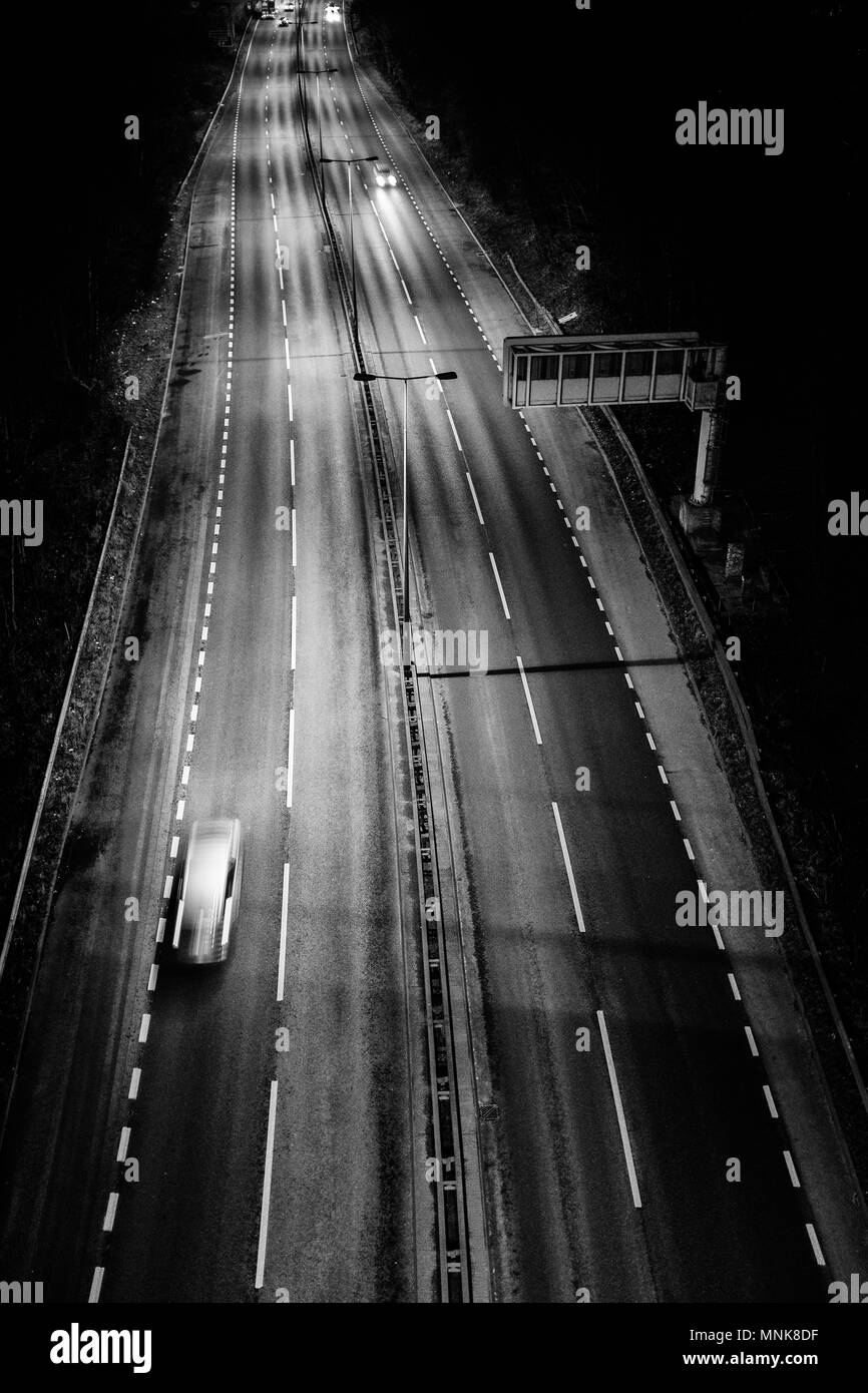 On the move vehicles on A63 dual carriage way at night, high angle view. Image taken from Humber Bridge north bank, Kingston upon Hull, England UK - Stock Image