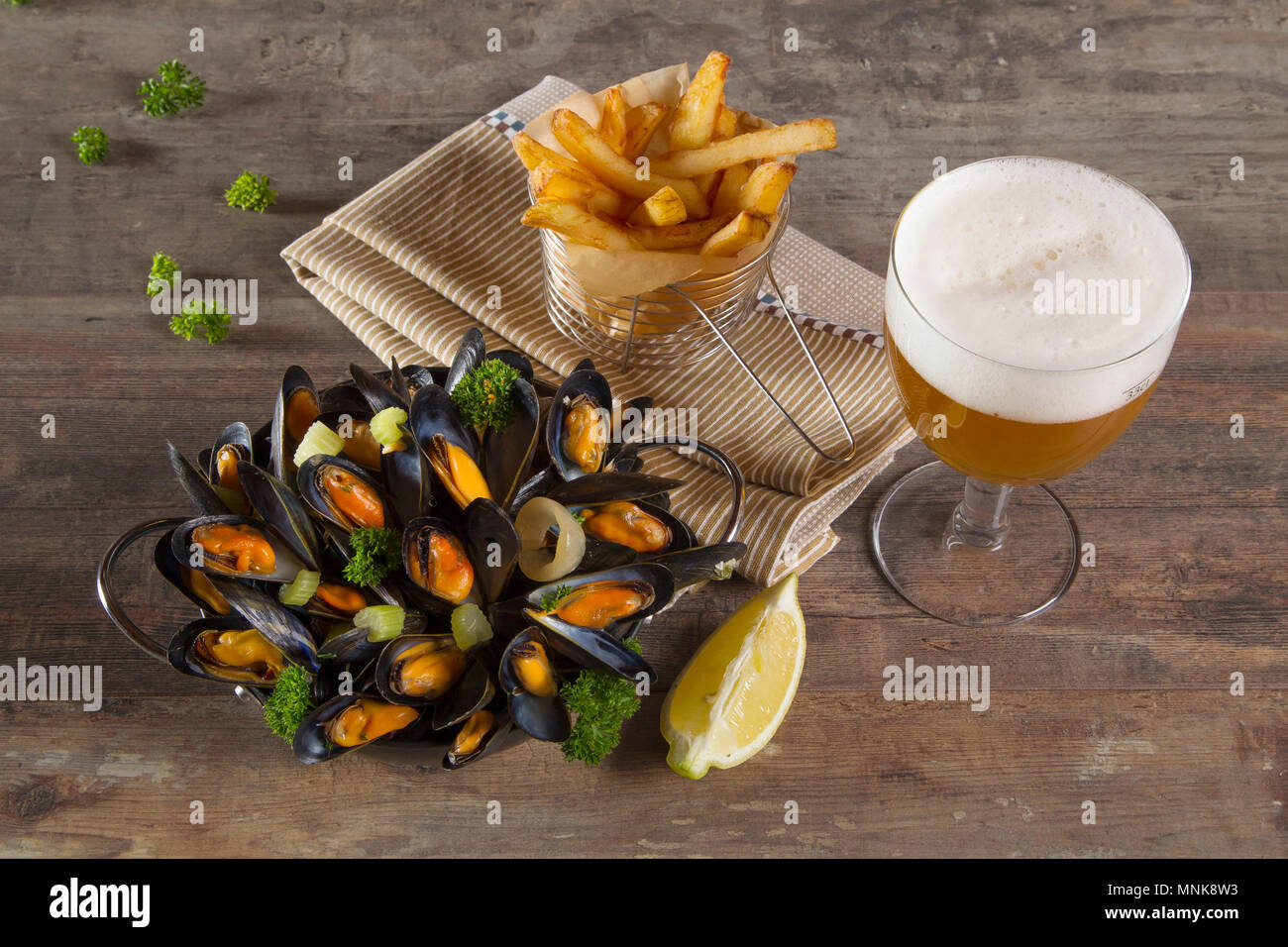 Mussels, French fries and half a pint of beer - Stock Image