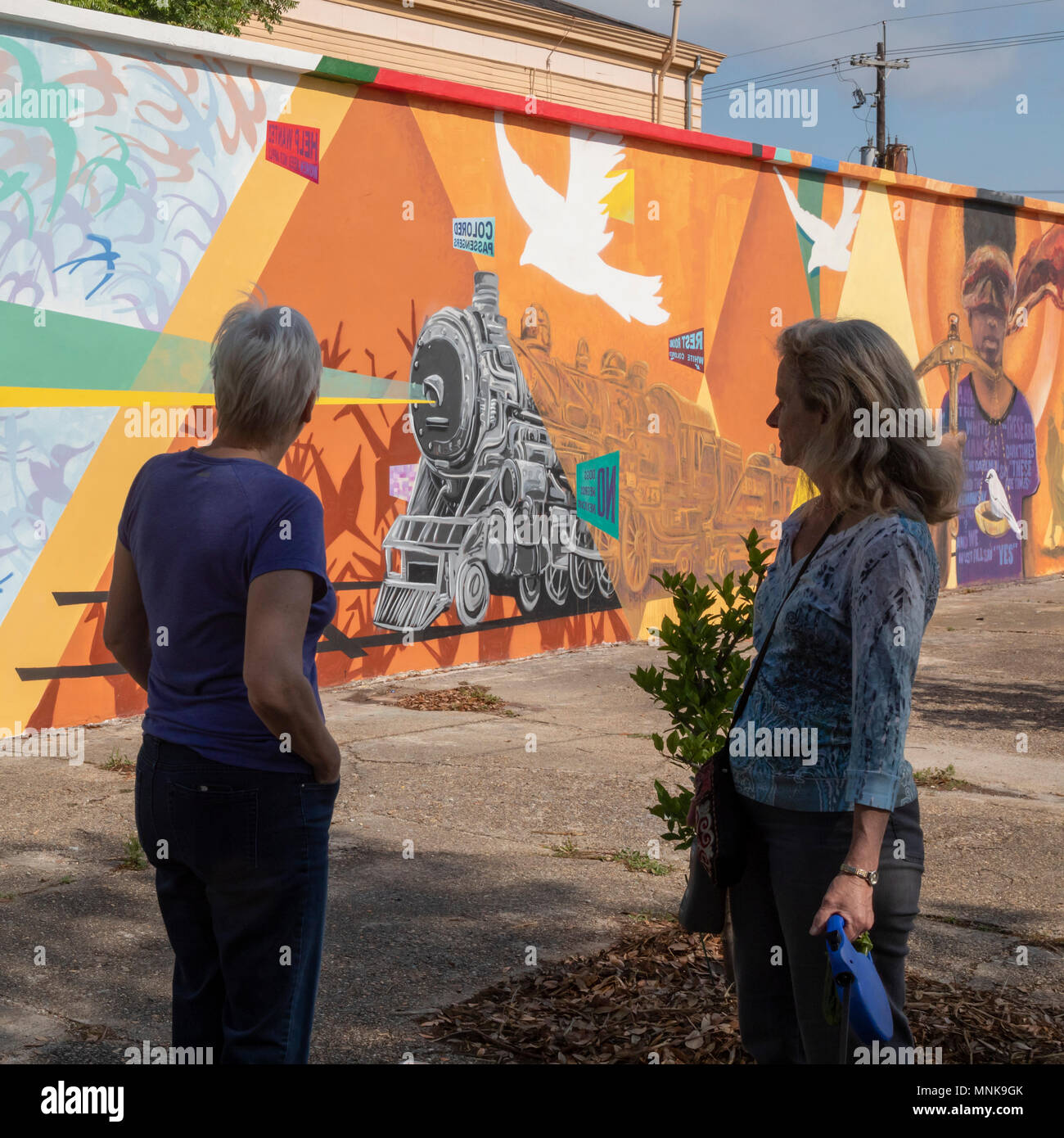 New Orleans, Louisiana - A painting by Ayo Scott honors Homer Plessy and the civil rights movement. Plessy was arrested on this spot in 1892. - Stock Image