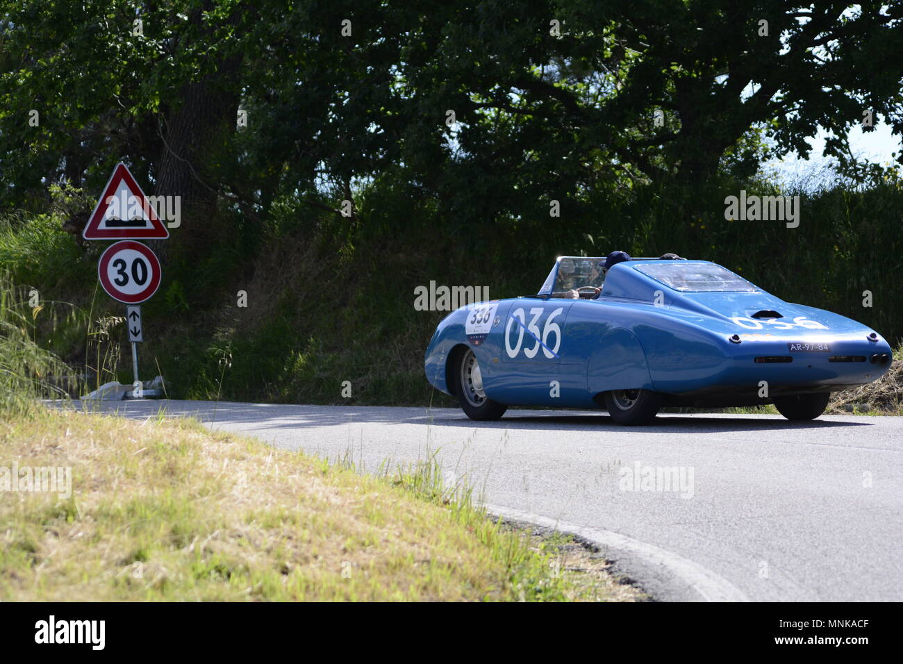 PESARO COLLE SAN BARTOLO , ITALY - MAY 17 - 2018 : AUTOBLEU 7501954  on an old racing car in rally Mille Miglia 2018 the famous italia Stock Photo