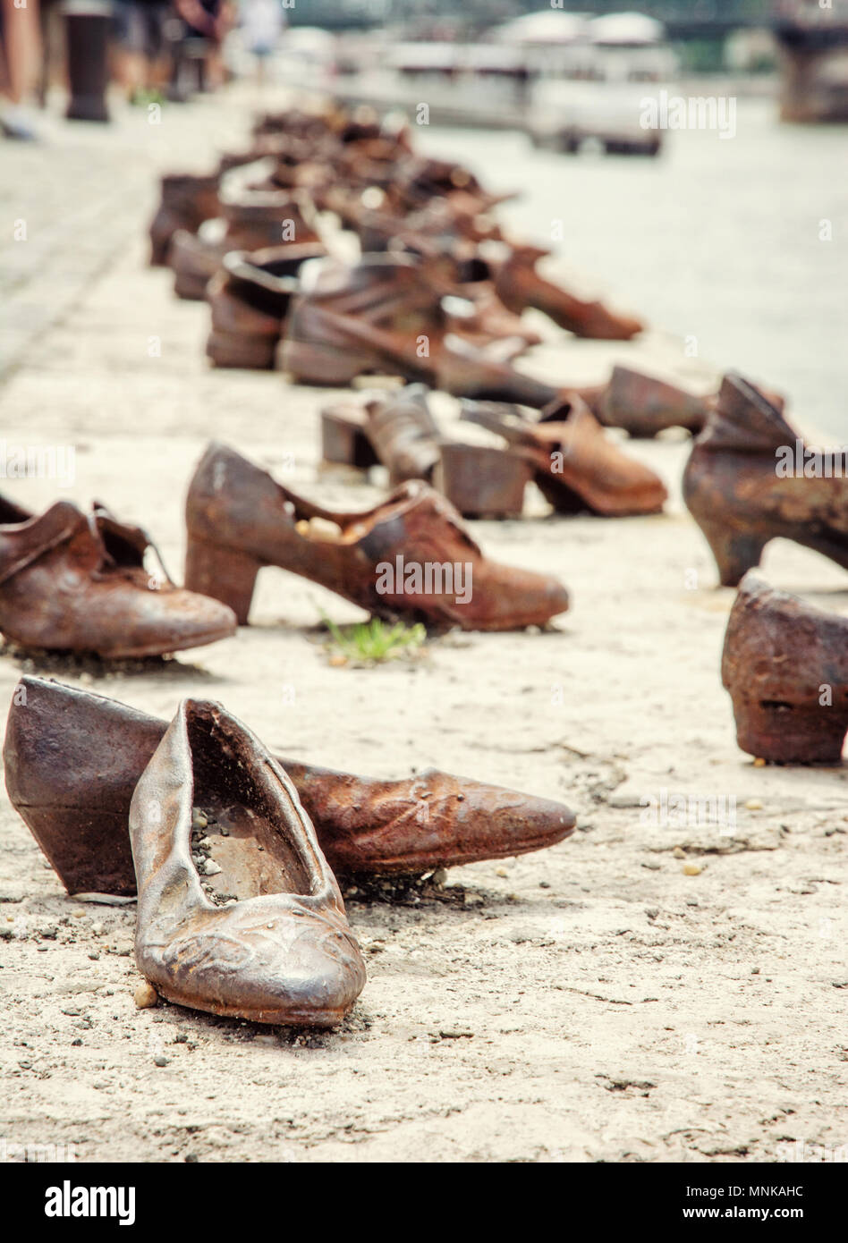 Shoes monument on the Danube bank is a memorial in Budapest, Hungary. Place of reverence. Symbolic object. Old photo filter. - Stock Image