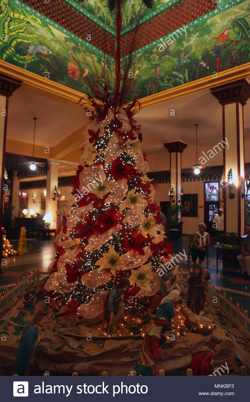 a decorated christmas tree in the lobby of a resort hotel in the dominican republic - Christmas In Dominican Republic