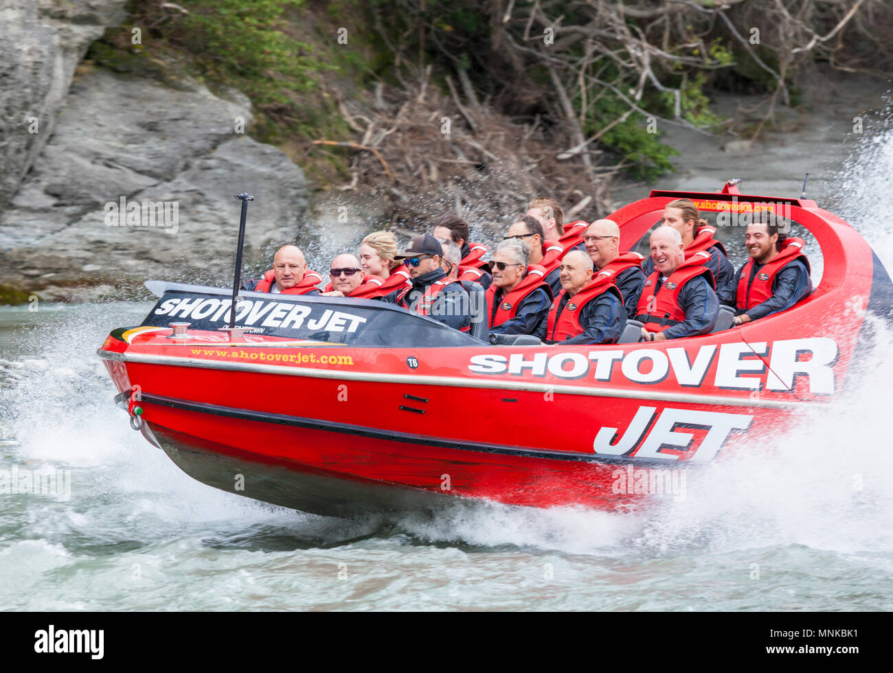 shotover jet boating near queenstown New Zealand South Island people in the shotover jet boating on the shotover river near queenstown new zealand - Stock Image