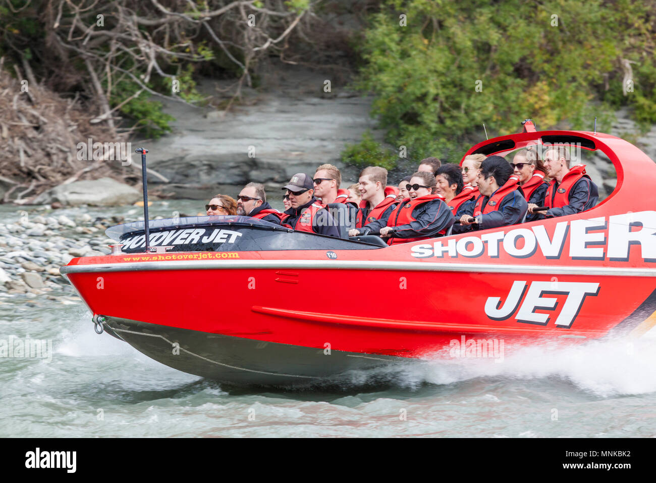 shotover jet boating on the shotover river near queenstown new zealand New Zealand queenstown New Zealand South Island nz - Stock Image
