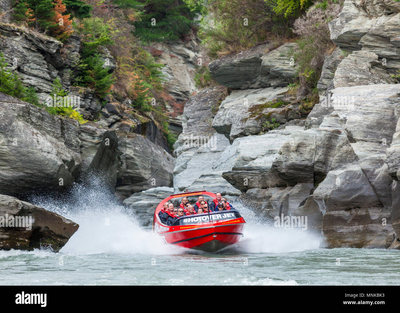 shotover jet boating on the shotover river through narrow canyon walls near queenstown new zealand New Zealand queenstown New Zealand South Island - Stock Image