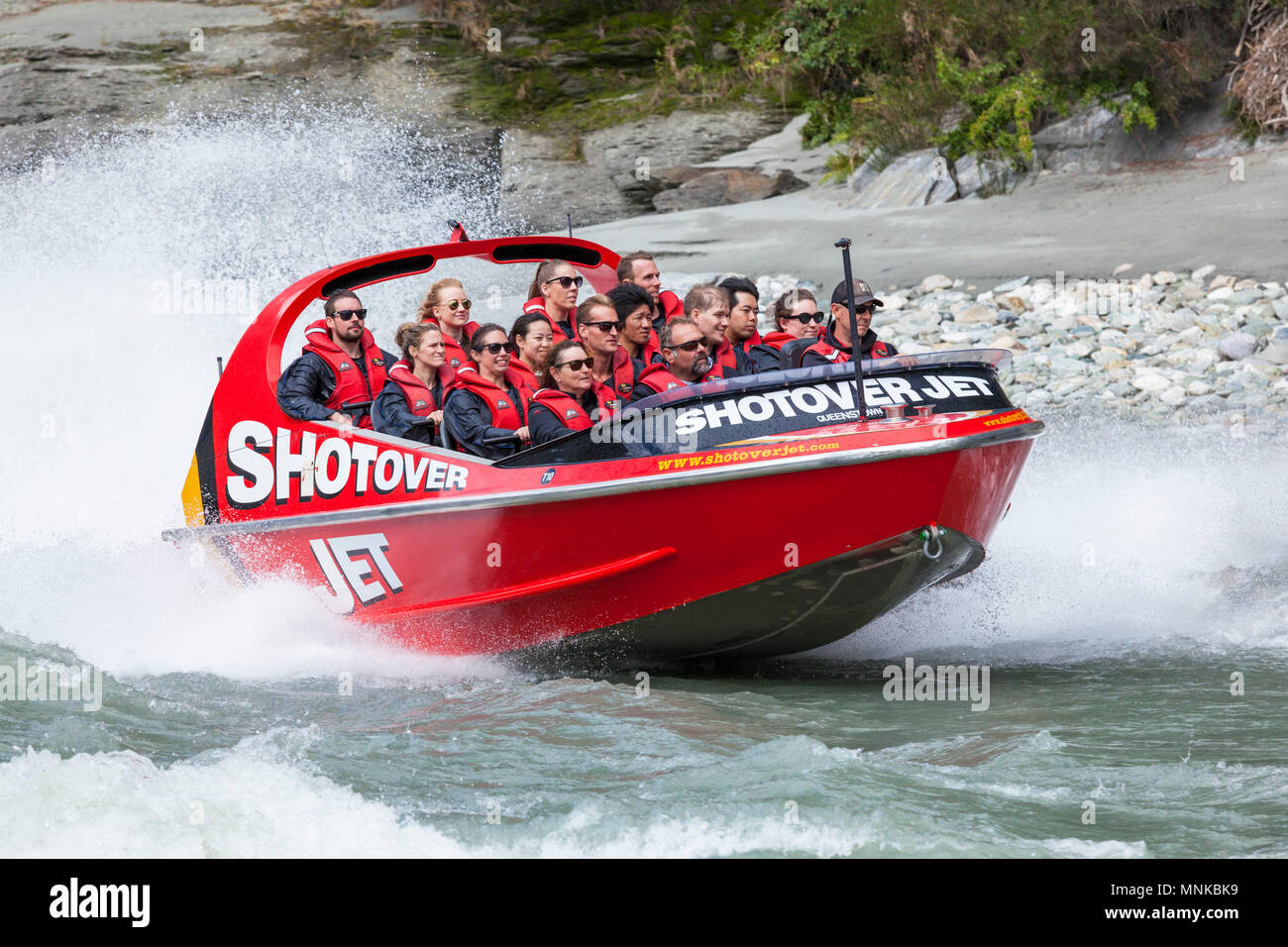 shotover jet boating on the shotover river near queenstown people new zealand New Zealand queenstown New Zealand South Island  nz - Stock Image