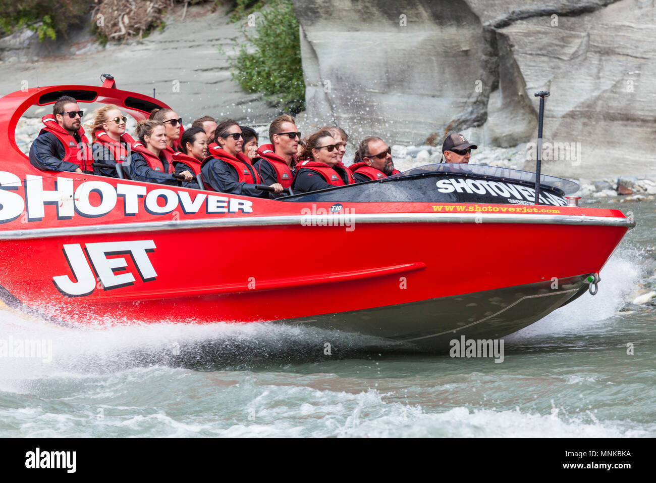 shotover jet boating on the shotover river near queenstown speeding near canyon walls New Zealand queenstown New Zealand South Island nz - Stock Image