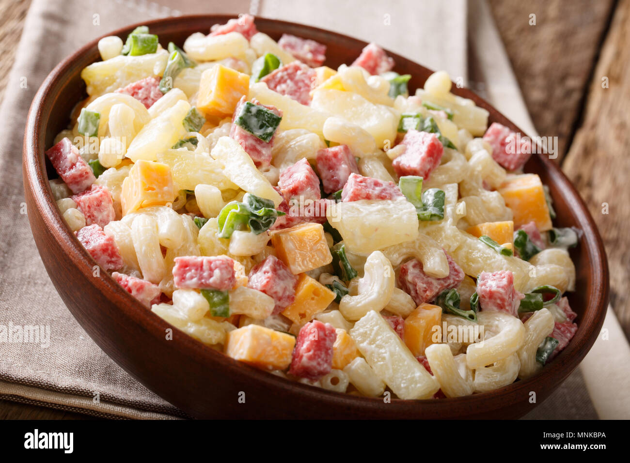 Hawaiian Food Salad With Pasta Ham Pineapple Onion Cheddar Cheese With Mayonnaise Close Up In A Bowl On The Table Horizontal