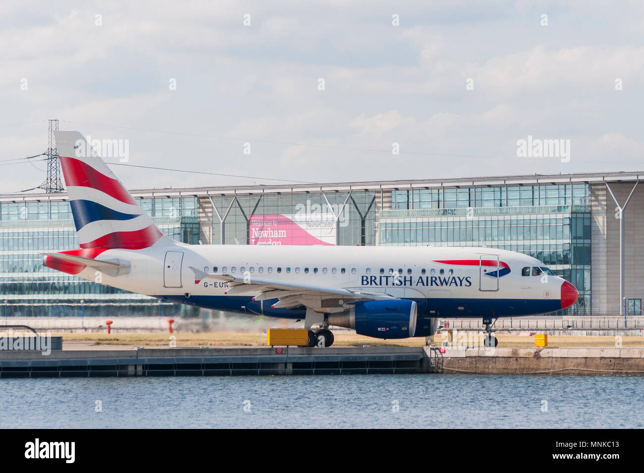 LONDON, UK - AUGUST, 2 2013; A British Airways Airbus A-318 (G-EUNB) rolls on the runway of the London City Airport in the borough of Newham before ta Stock Photo