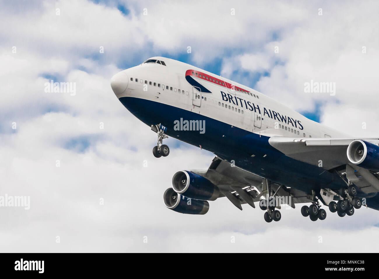 LONDON, UK - AUGUST, 6 2013; A British Airways Airbus Boeing 747 landing at London Heathrow Airport Stock Photo