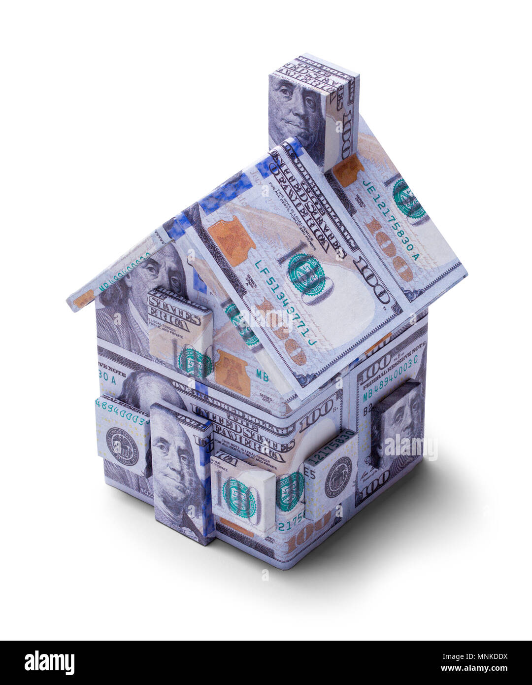 House Covered on One Hundred Dollar Bills Isolated on a White Background. - Stock Image