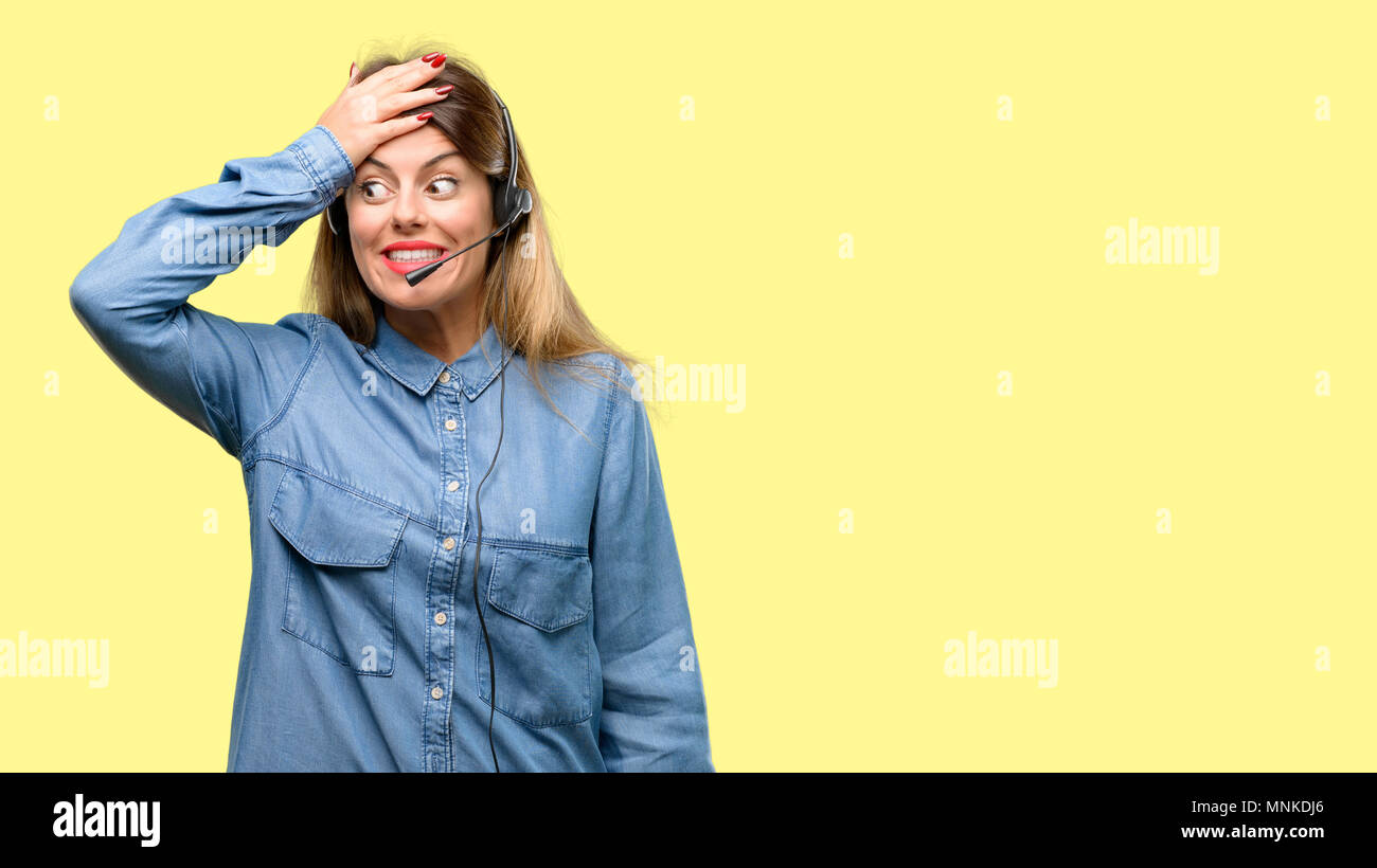 Consultant of call center woman in headphones terrified and nervous expressing anxiety and panic gesture, overwhelmed - Stock Image