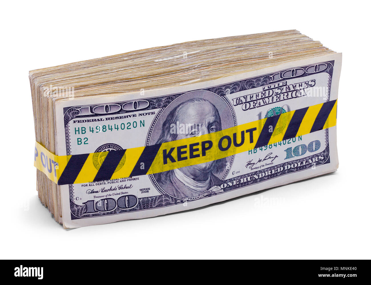 Wad of Hundred Dollar Bills with Keep Out Tape Isolated on White. - Stock Image