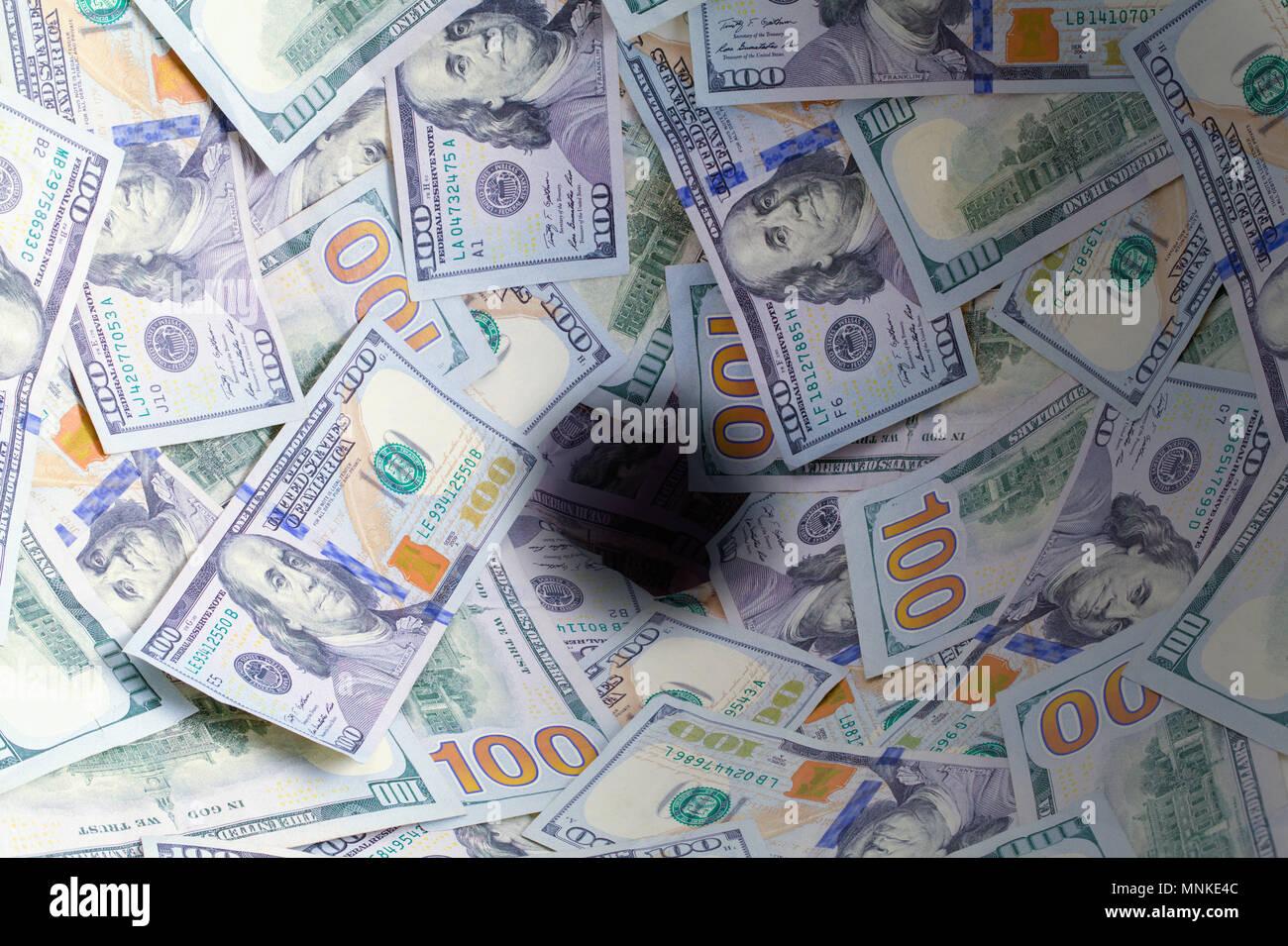 Hundred Dollar Bills Going Down the Drain. - Stock Image