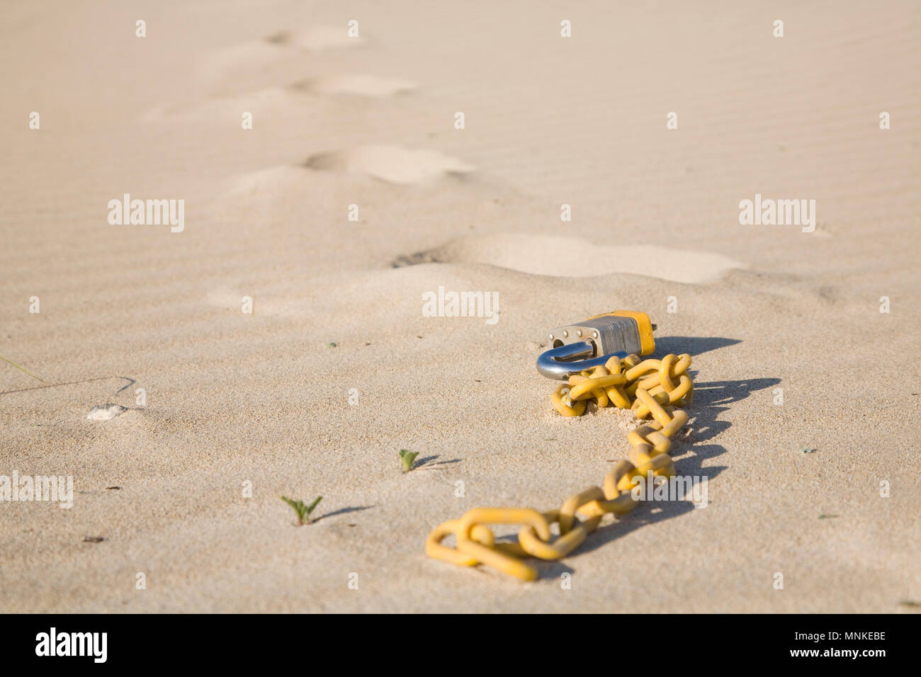 A breaking free concept with footprints leading away from