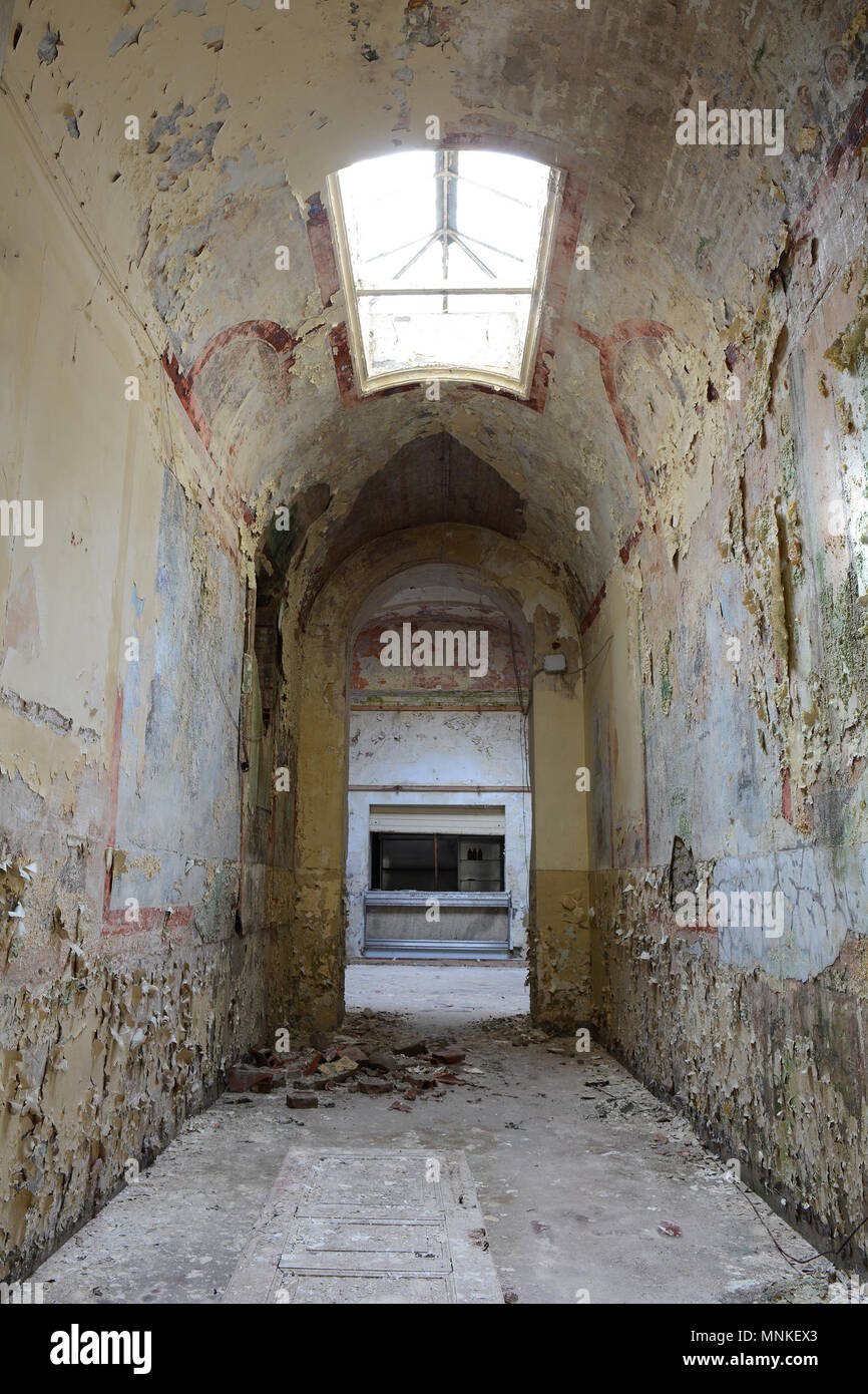 Hallway with Skylight in Old Abandoned Psychiatric Hospital Building in Italy - Stock Image