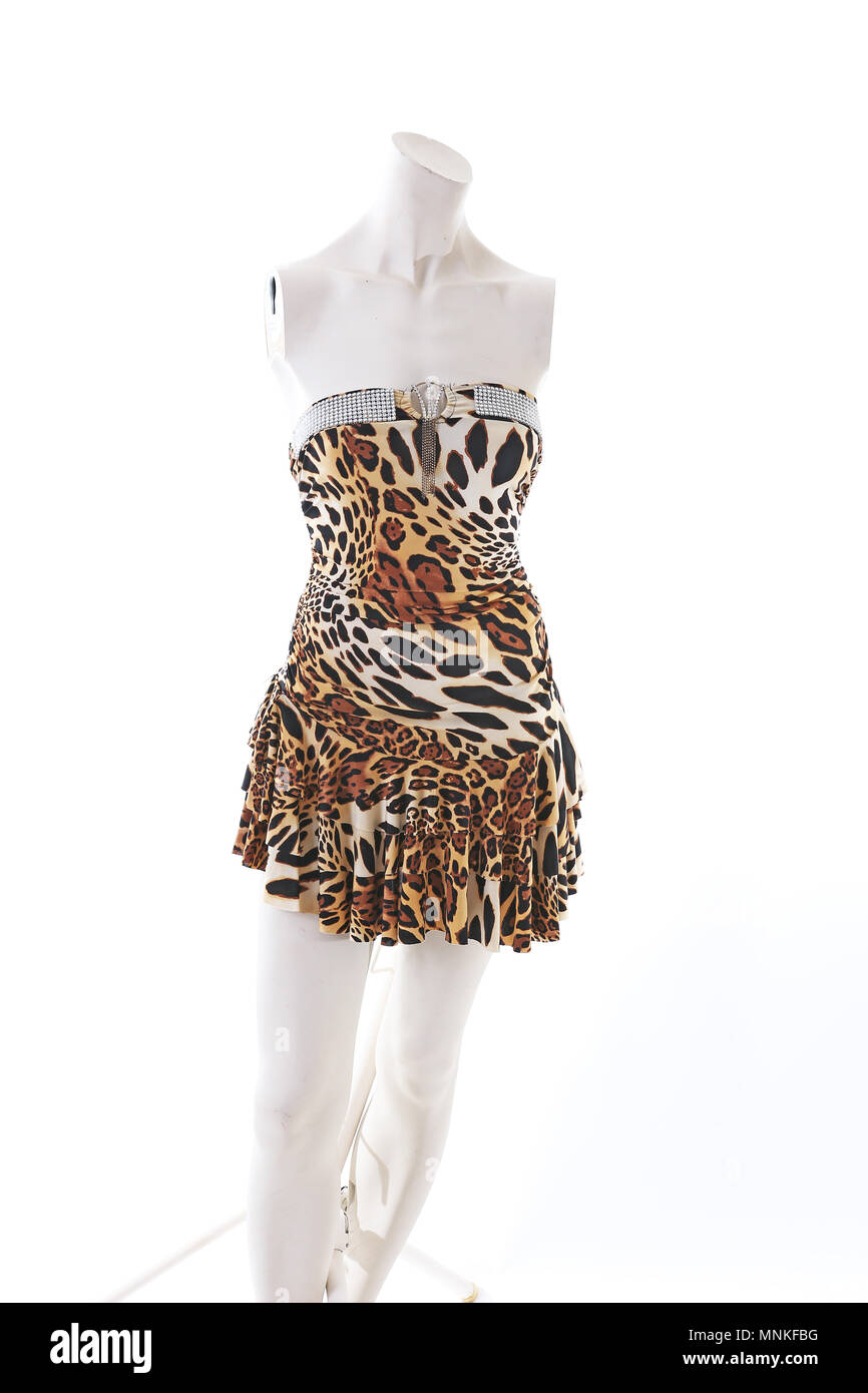 Animal pettern mini dress on mannequin full body shop display. Woman fashion styles, clothes on white studio background. - Stock Image