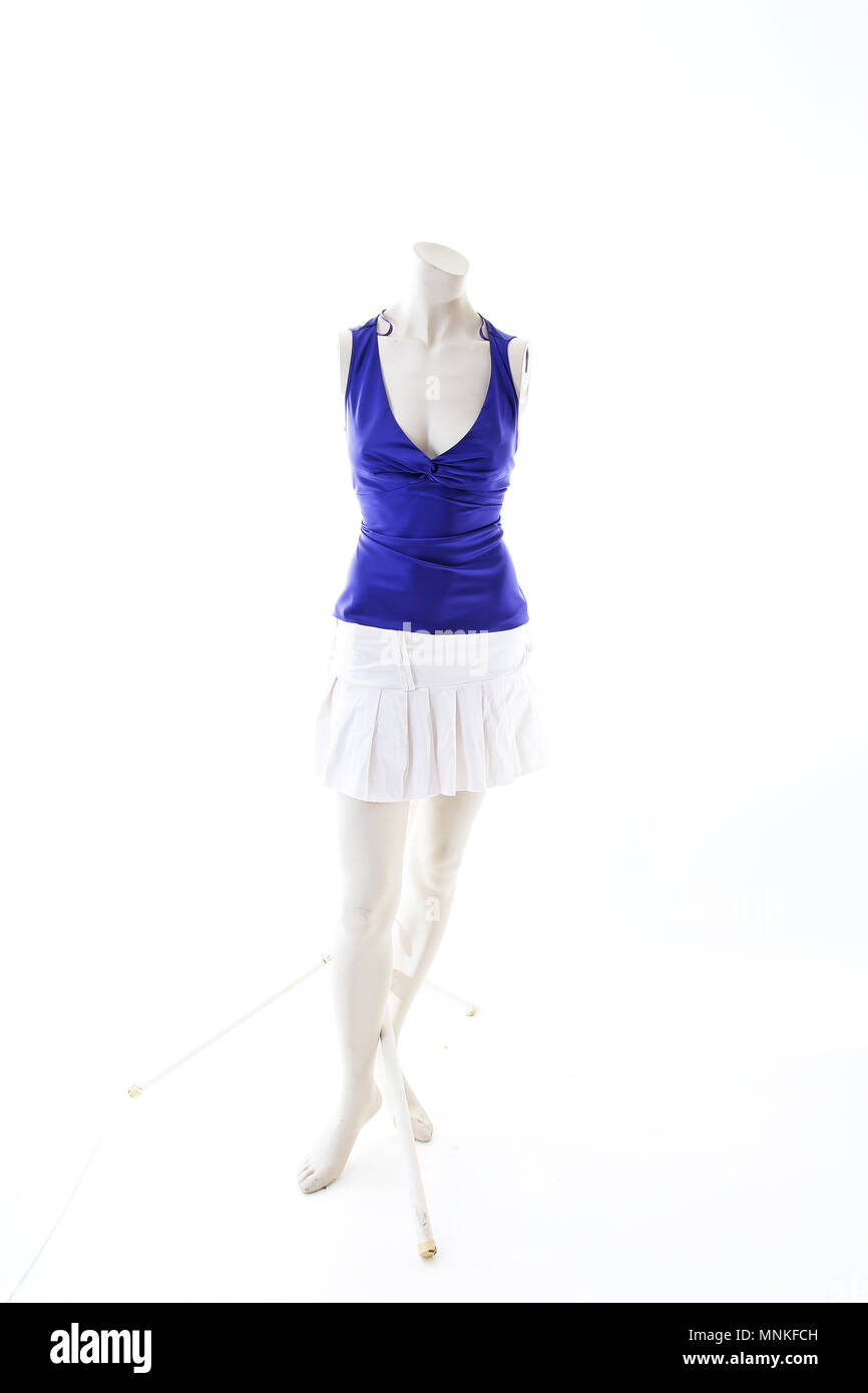 Blue top with mini skirt summer style on mannequin full body shop display. Woman fashion styles, clothes on white studio background. - Stock Image