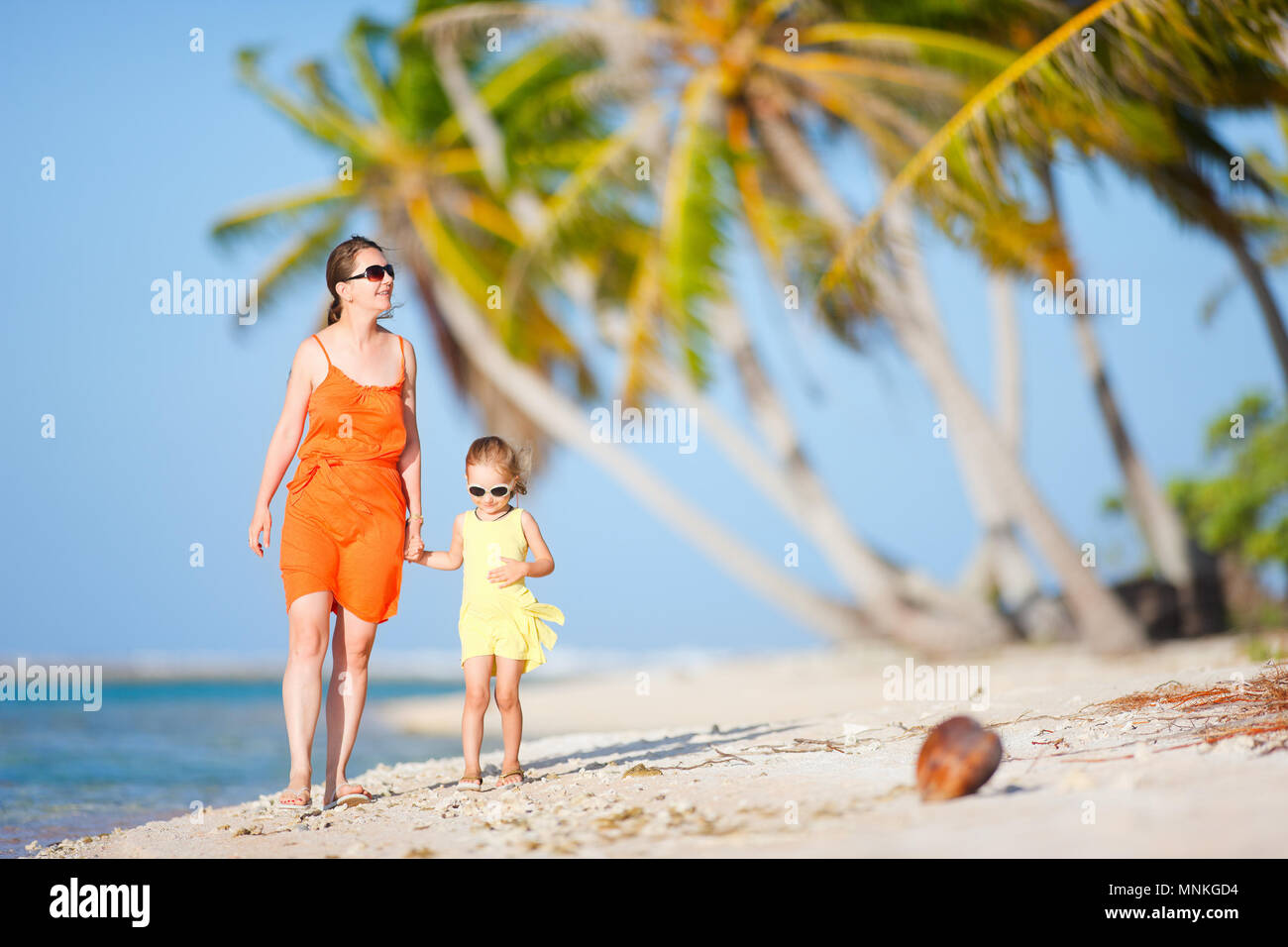 Beautiful mother and daughter on a deserted island - Stock Image
