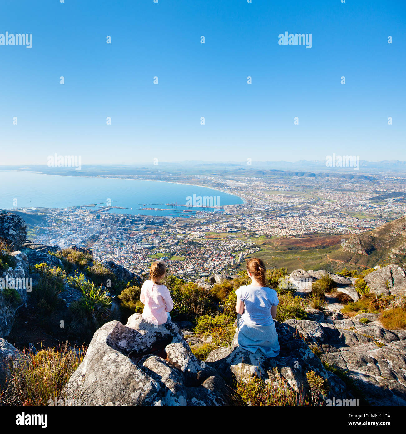 Family enjoying breathtaking views of Cape Town from top of Table mountain - Stock Image