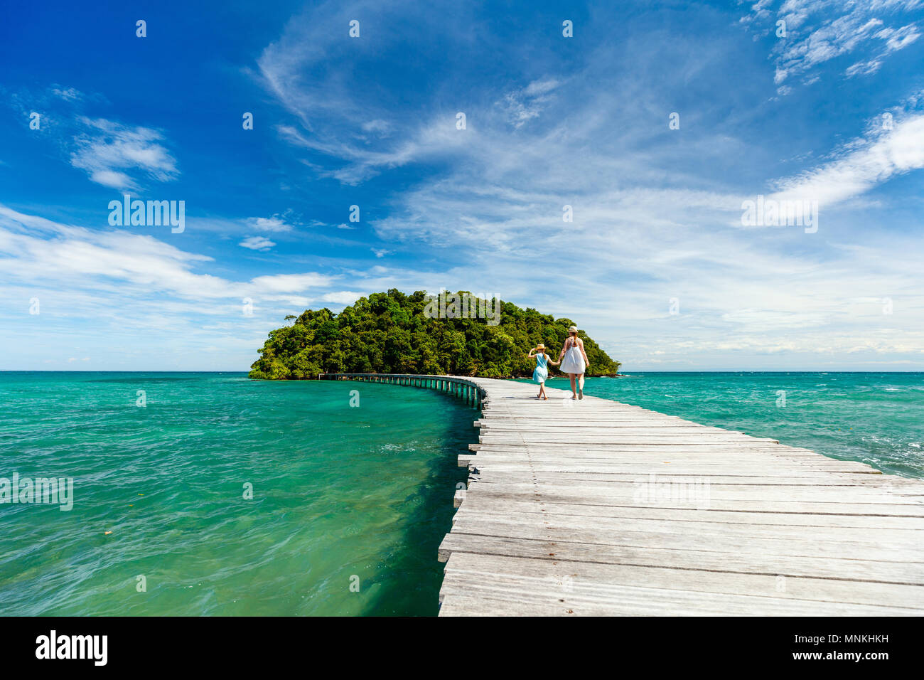 Wooden pathway leading to beautiful tropical island in Cambodia - Stock Image