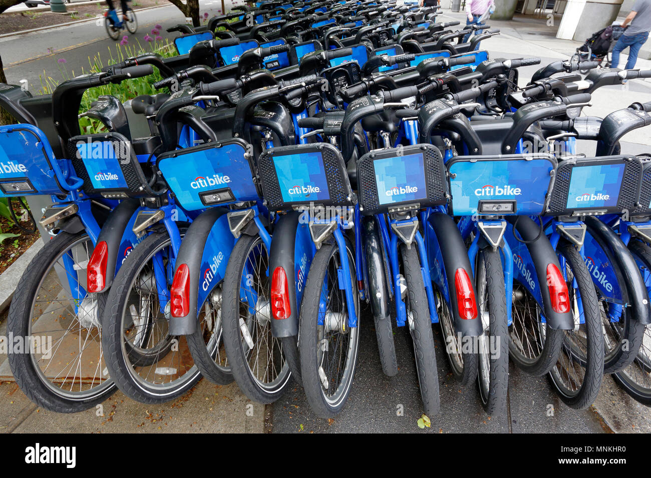 Citibikes piled together at a valet station - Stock Image
